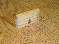 I used a laser to mark a straight line down the centre of the workbench.