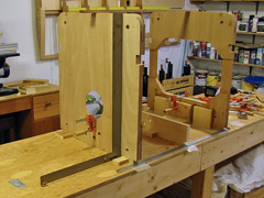 Forward seat blocks glued to F-3. I checked the alignment of all parts with a straightedge and carpenter's square.