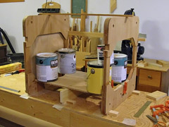 """Seat glued in place and """"clamped"""" with paint cans."""