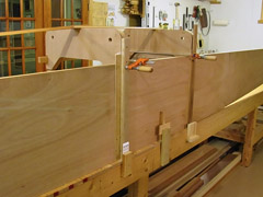 Slightly bowed 1x2 lumber was clamped with blocks at the bottom, and 2' clamps at the top.