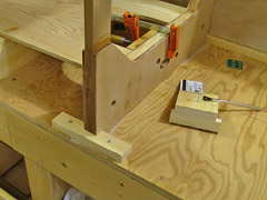 Pine blocks ensure that the bulkheads won't move from the clamping pressure.