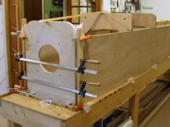 Fuselage sides clamped to firewall.