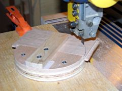 By rotating the platform, the saw cuts a perfect semi-circle out of the blanks.
