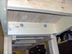 "Workbench sections joined by 3/8"" bolts."